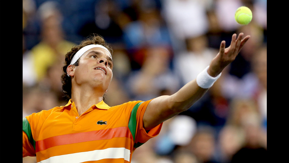 Canadian player Milos Raonic of Canada prepares to serve on Monday.