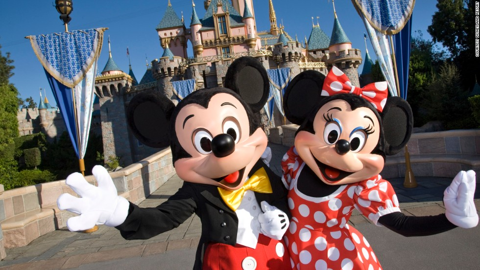 3. There's nothing like visiting the original Disneyland, featuring Mickey and Minnie Mouse in front of Sleeping Beauty Castle in Anaheim, California.
