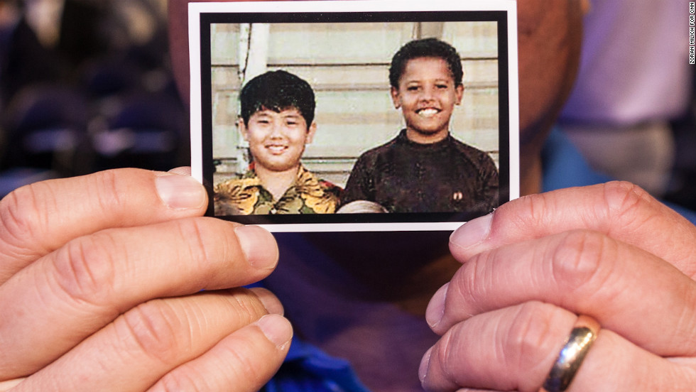 Dean Ando, a delegate from Washington, holds up a picture of himself and Barack Obama as fifth-graders at the Punahou School in Hawaii at the Democratic National Convention on Tuesday.