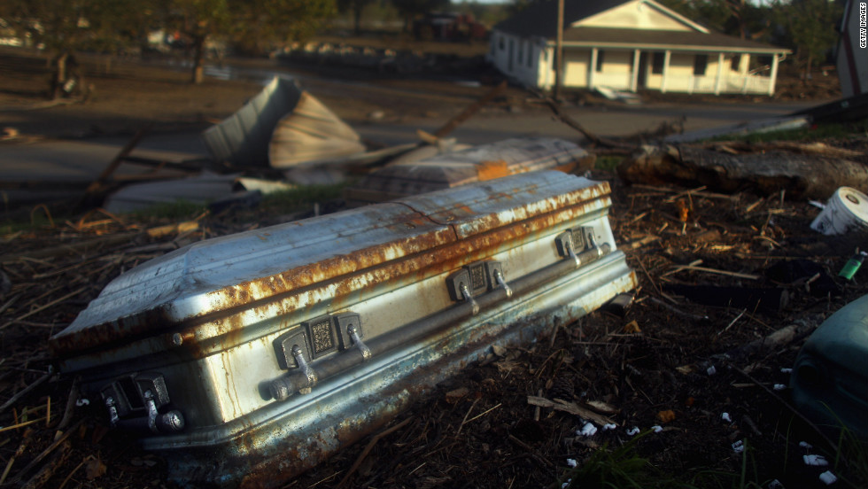 A coffin lies on the side of a levee Monday in Braithwaite, Louisiana, washed up by floodwaters from Hurricane Isaac.