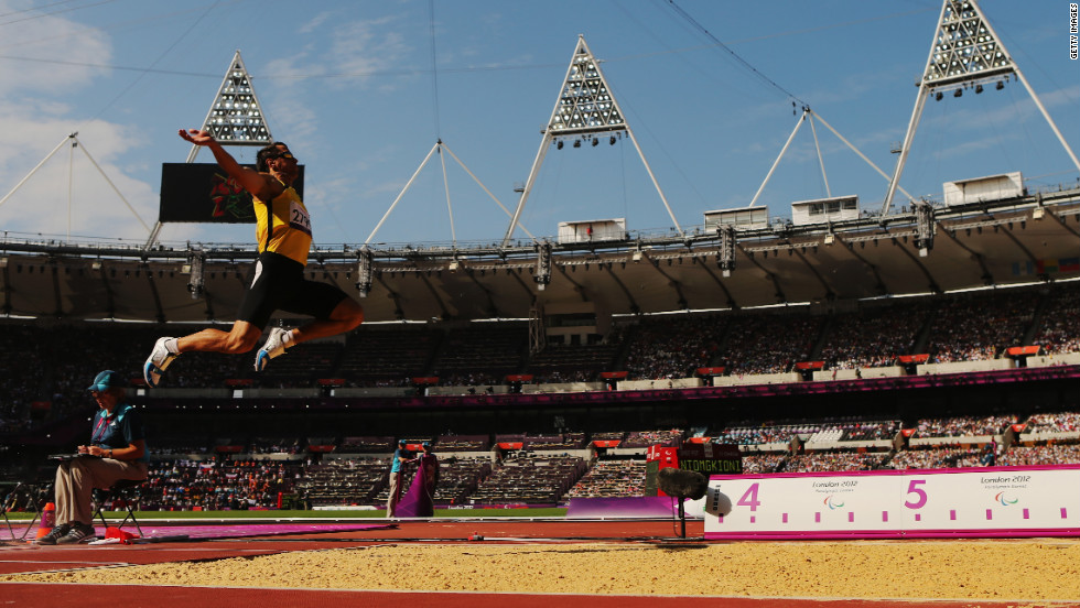 Ruslan Katyshev of Ukraine competes in the men's long jump F11 final Tuesday.
