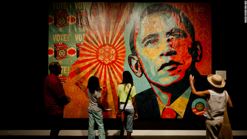 People stop to look at a mural by artist Shepard Fairey on Monday, September 3.
