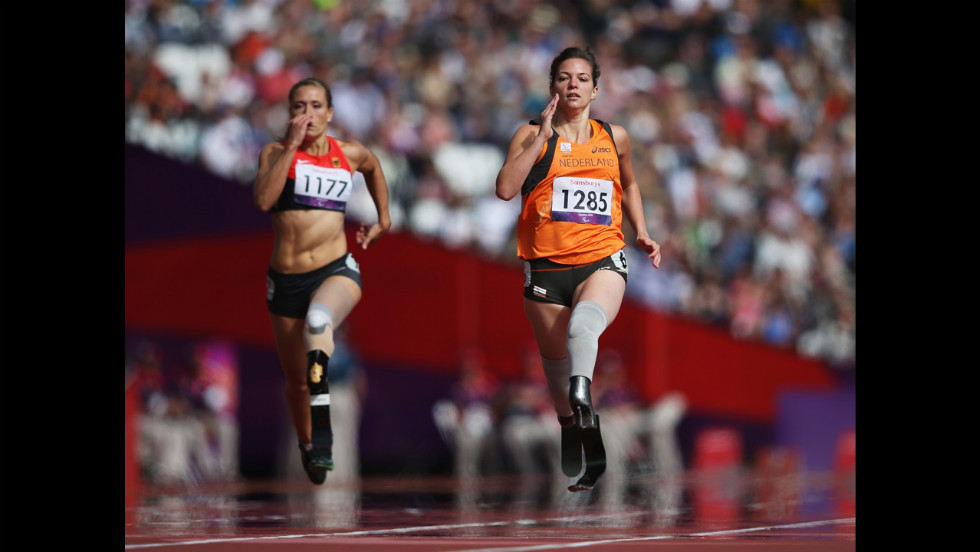 Katrin Green, left, of Germany and Marlou van Rhijn of the Netherlands compete in the women's 200-meter T37 heats at Olympic Stadium on Wednesday.