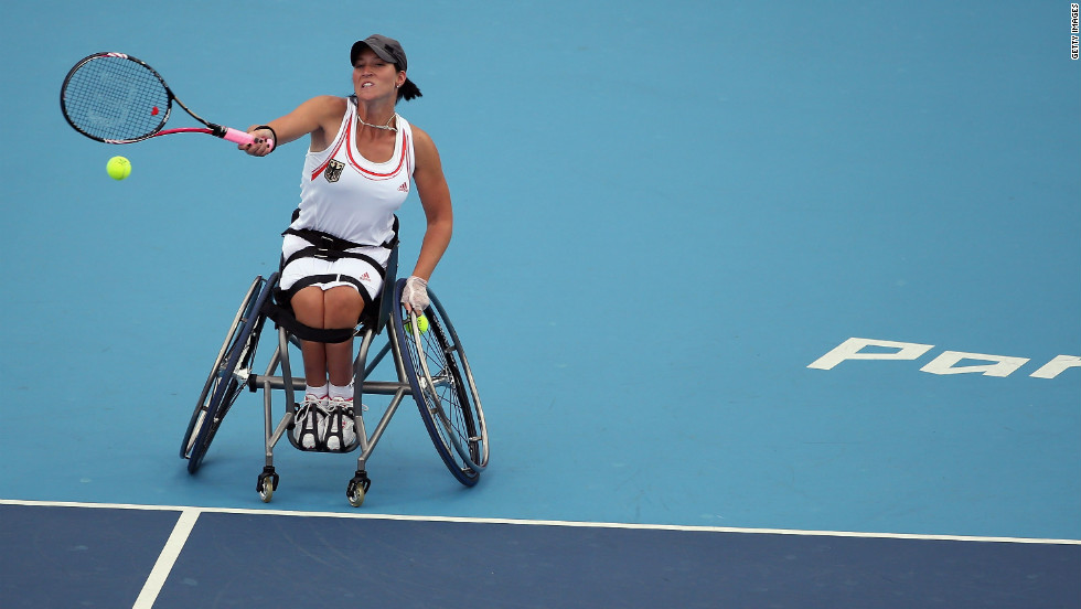 Katharina Kruger of Germany plays a shot while competing with Sabine Ellerbrock against Jordanne Whiley and Lucy Shuker of Great Britain during the women's doubles wheelchair tennis quarterfinal match on Tuesday.