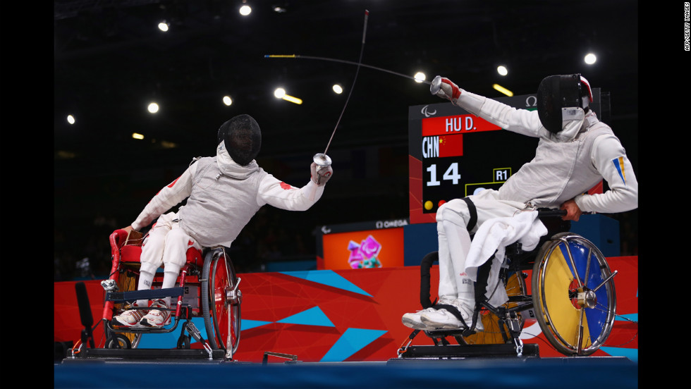 Chinese Daoliang Hu, left, on his way to winning gold against Ukrainian Anton Datsko on Tuesday during the men's final of wheelchair fencing.