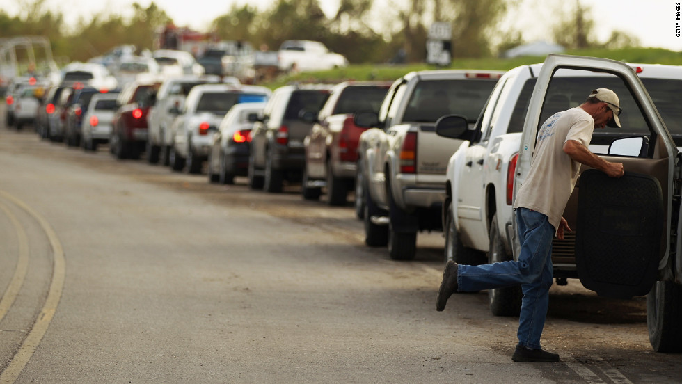 Returning residents wait in line Tuesday for a ferry in Plaquemines Parish.