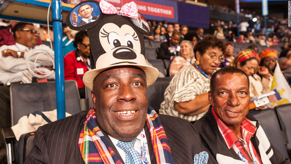 Virgin Islands delegate Edgar Baker Phillips wears a Minnie Mouse hat with Obama on top of it Tuesday.