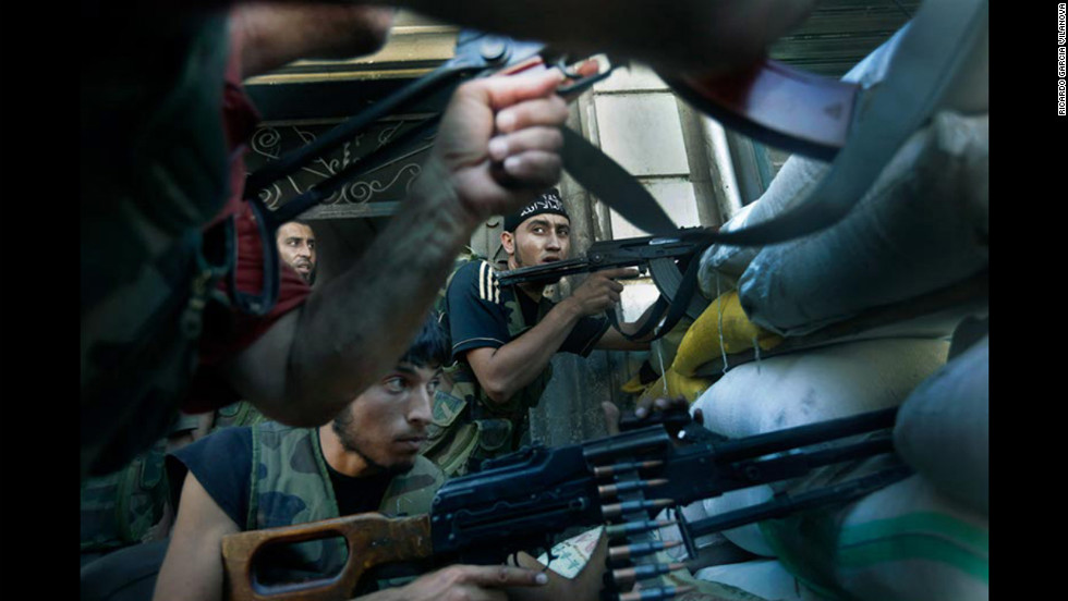Members of the rebel army fight back against forces loyal to al Assad's regime.