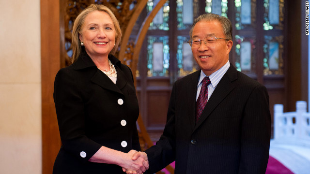Hillary Clinton shakes hands with Chinese State Councilor Dai Bingguo in Beijing on Wednesday, day two of the DNC.