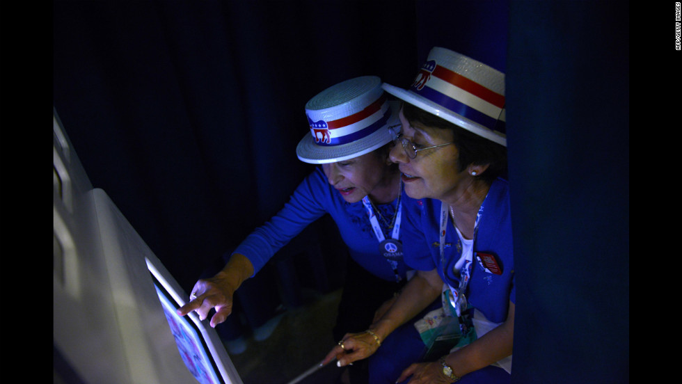 Priscilla Marquez and Evie Walls from Arizona pose in the Google photo booth on Wednesday.