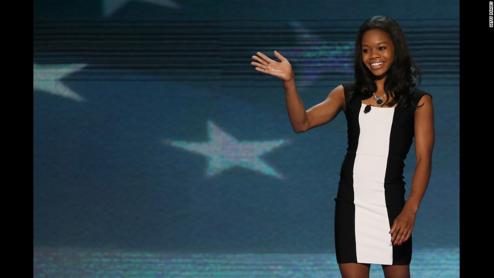 Olympic gymnast Gabby Douglas waves after leading the Pledge of Allegiance on Wednesday.