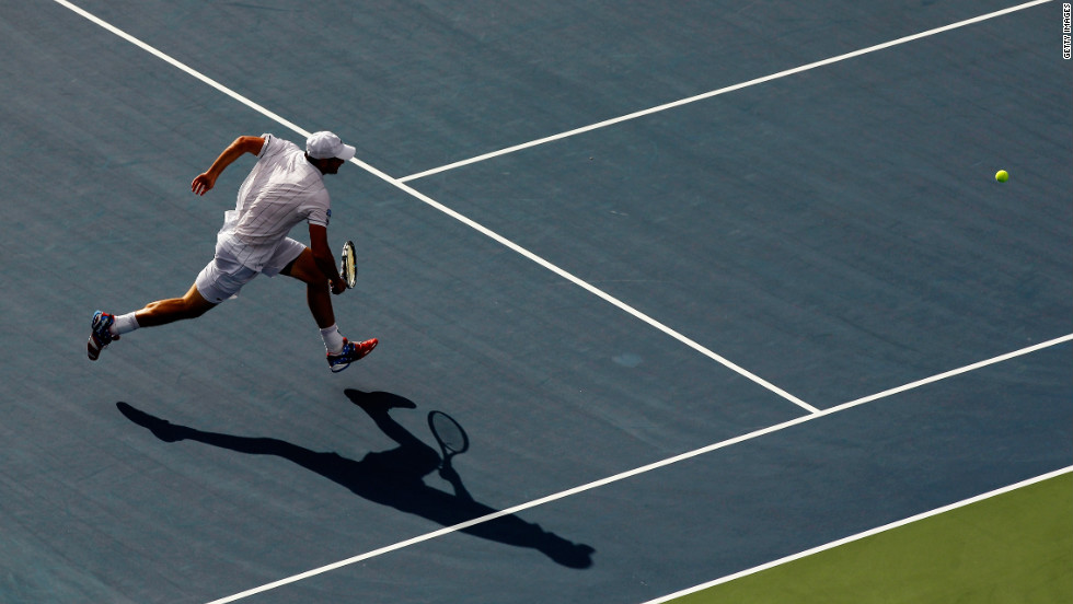 Roddick chases down the ball during his match against del Potro on Wednesday. Roddick announced he would retire after this Grand Slam.