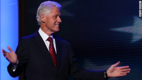 Former U.S. President Bill Clinton waves as he takes the stage
