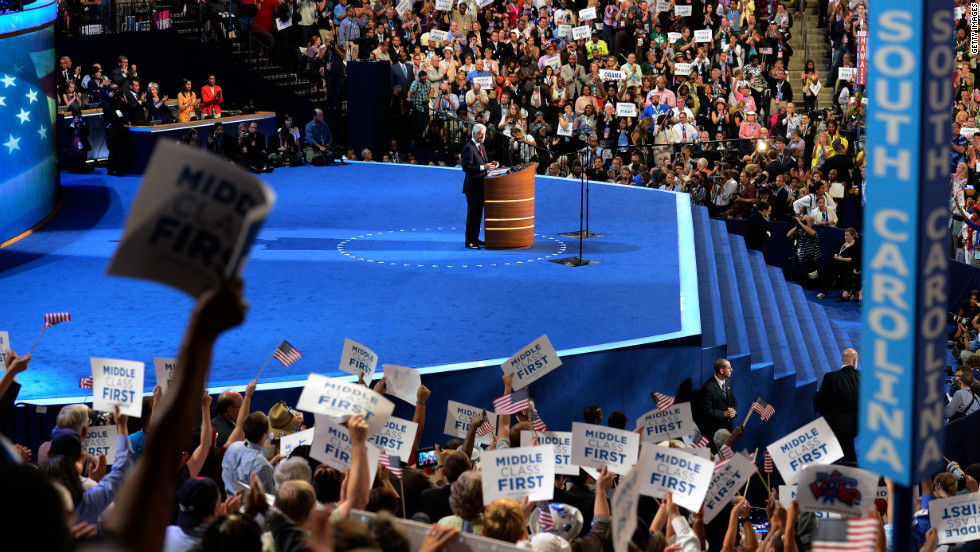 The crowd cheers as Bill Clinton makes his case Wednesday for the re-election of Barack Obama.