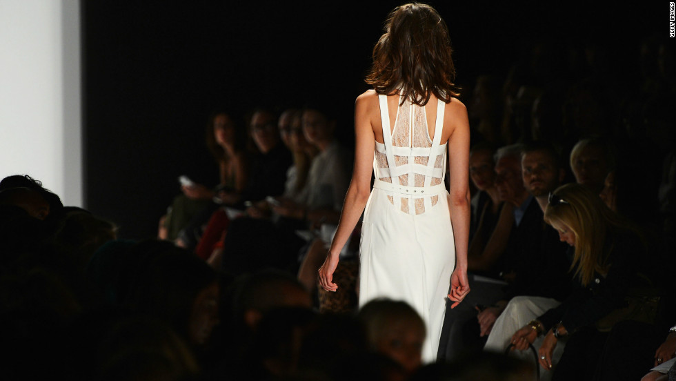 Max Azria of BCBG balanced textures by pairing delicate fabrics with bondage elements.