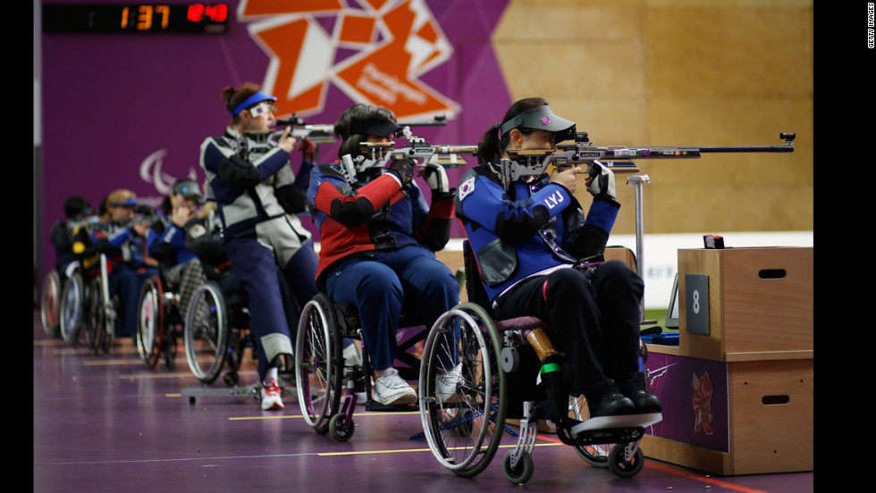 Yoojeong Lee of the Republic of Korea, right, shoots during the women's R8-50m rifle 3 positions-SH1 final on Thursday.