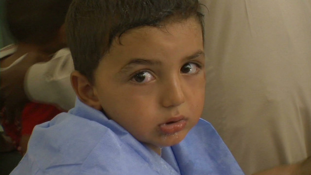 Treating children at an Aleppo hospital
