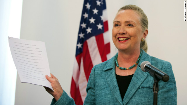 Hillary Clinton holds up a copy of her husband's DNC speech during a press conference in Dili, East Timor on September 6, 2012.