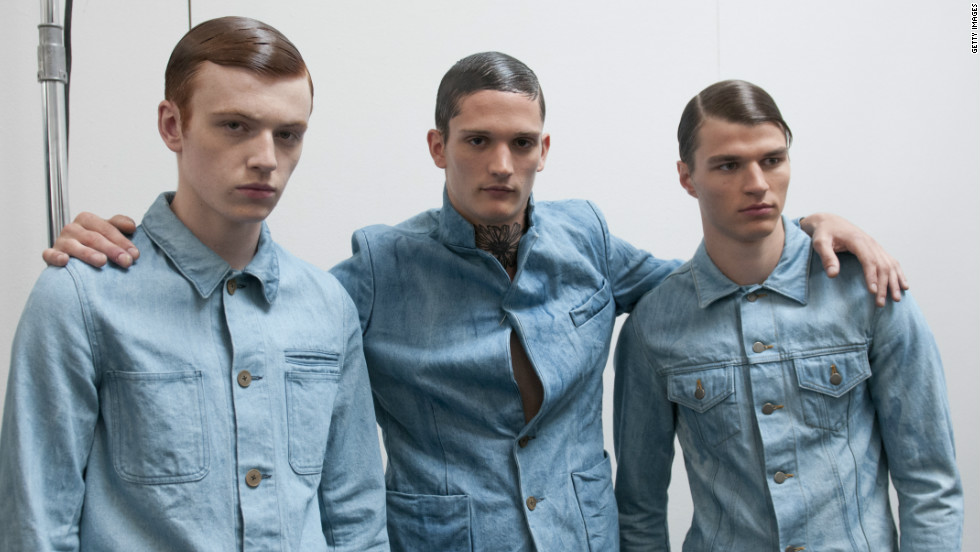 Three male models looking sleek backstage at the Duckie Brown Spring 2013 fashion show.