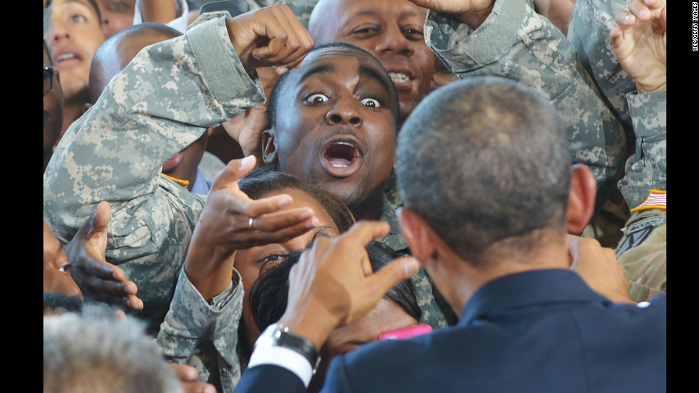Obama greets troops after delivering remarks at Fort Bliss.