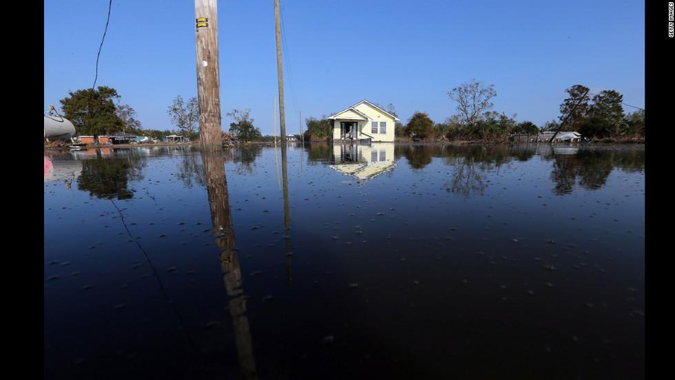 Floodwaters linger Thursday in Braithwaite, Louisiana.