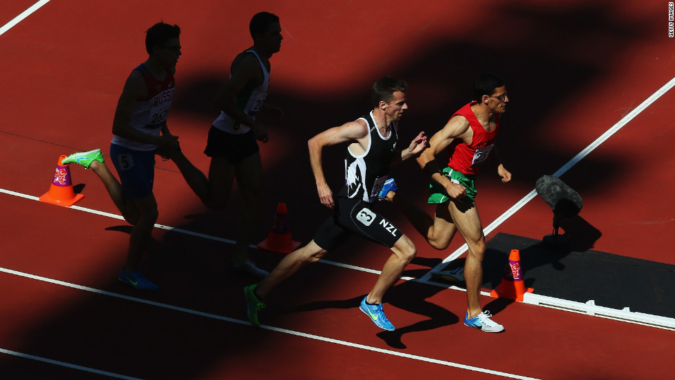 New Zealand's Tim Prendergast, No. 3, competes in the 800-meter T13 round 1 heat 1 on Friday.