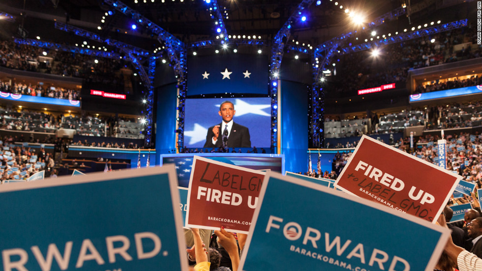 Some attendees hold up modified signs during the president's speech on Thursday.