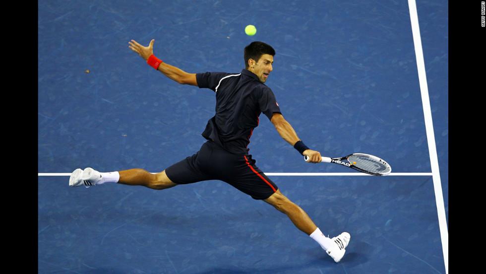 Djokovic returns a shot.