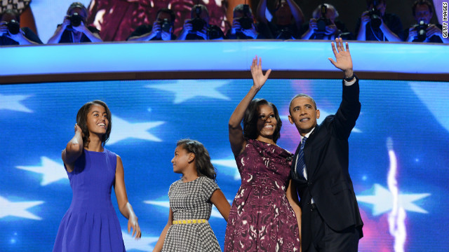 President Barack Obama, First lady Michelle Obama, daughters Malia (L) and Sasha (2nd-L) wave after Obama's nomination acceptance speech in Charlotte, North Carolina