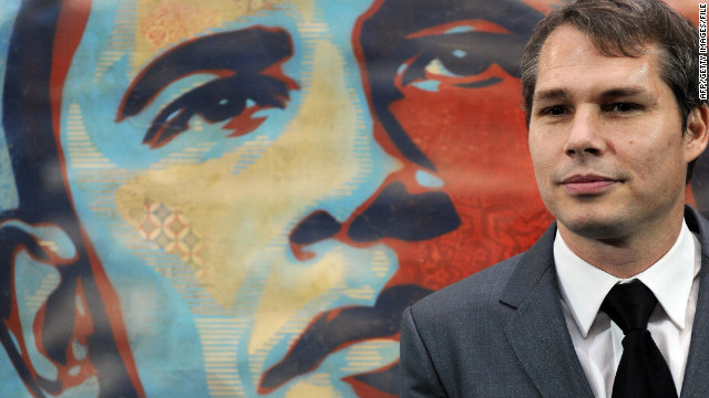 Artist Shepard Fairey stands in front of his image of U.S. President Barack Obama on January 17, 2009.