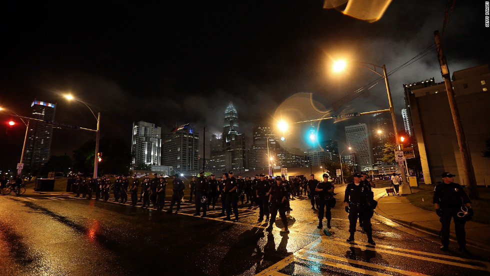 <strong>2012: </strong>Police officers face off with protesters blocking the road during a march outside the Charlotte (North Carolina) Convention Center on September 4, the first day of the Democratic National Convention.