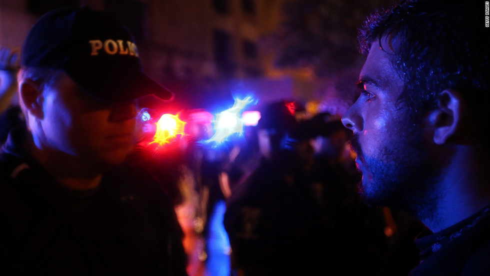 <strong>2012:</strong> In Charlotte, a police officer faces off with a protester blocking the road.