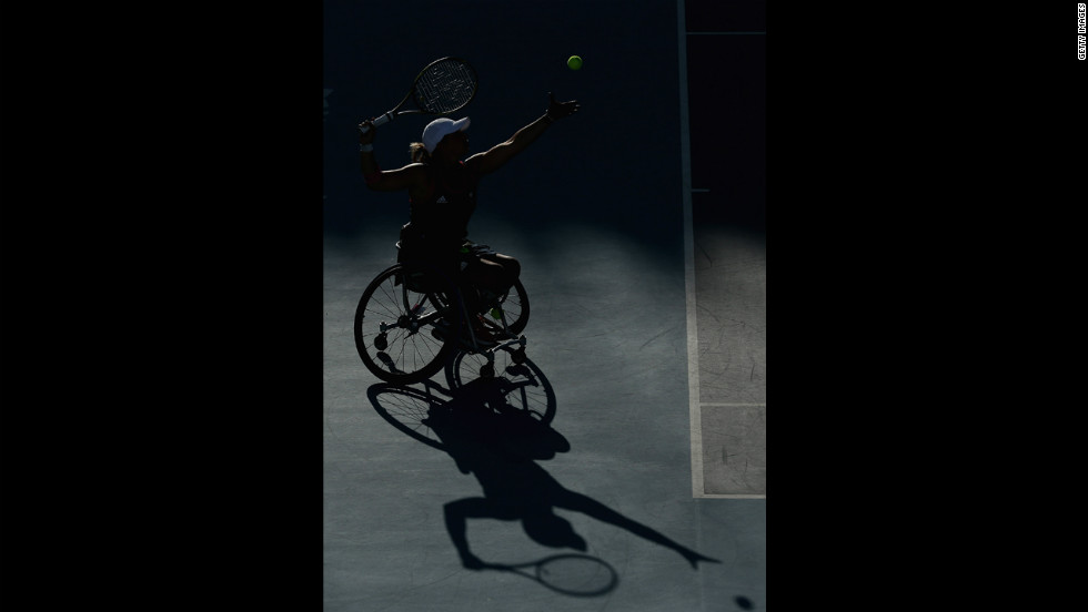 A shadow of Lucy Shuker serving with partner (out of frame) Jordanne Whiley of Great Britain to Sakhorn Khanthasit and Ratana Techamaneewat of Thailand in the women's doubles bronze medal match for wheelchair tennis on Friday.