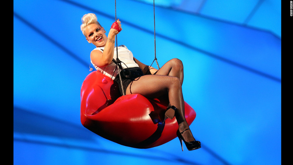 "Singer Pink descends on giant red lips during her performance of her latest single, ""Blow Me (One Last Kiss)."""