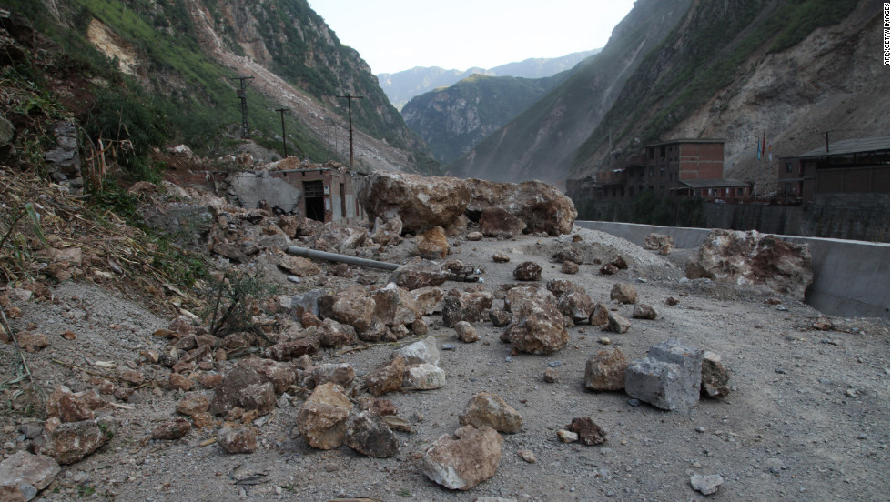 Fallen rocks block a road in Yiliang.