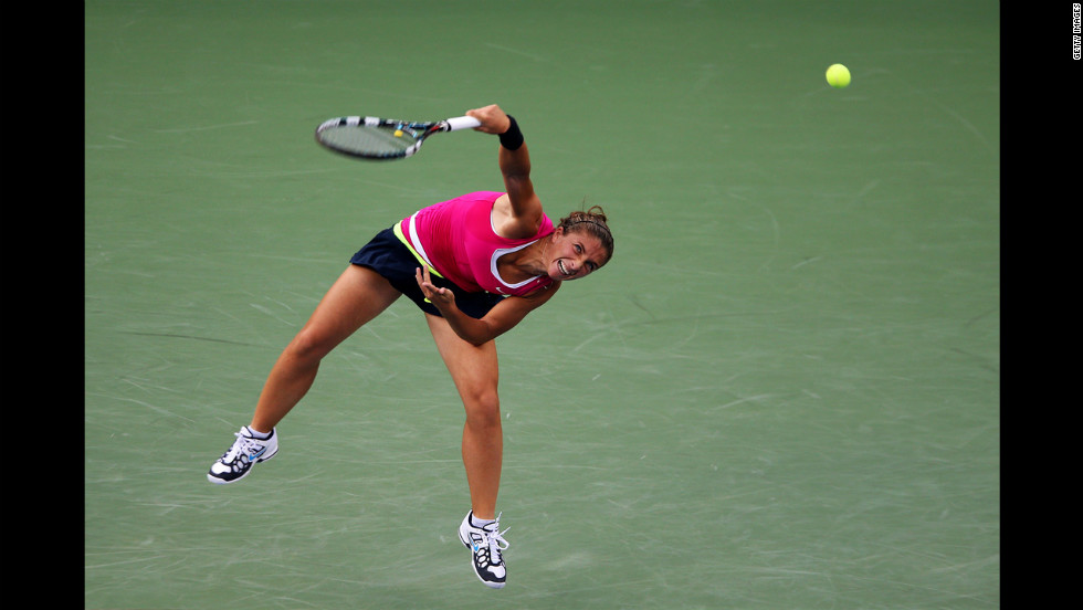 Sarah Errani of Italy serves in her match against Serena Williams of the United States during a women's singles semifinal match Friday.