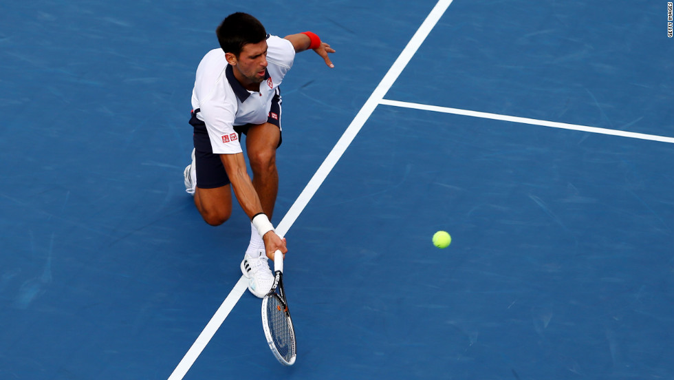 Djokovic returns a shot against against Ferrer during their men's singles semifinal match of the 2012 US Open on Saturday, September 8.  The match was stopped in the middle of the first set due to approaching severe weather and resumed on Sunday.