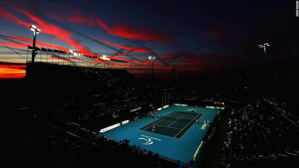 The sun sets as Shingo Kunieda of Japan, front left, plays against Stephane Houdet of France in the men's wheelchair tennis gold medal match on Saturday.