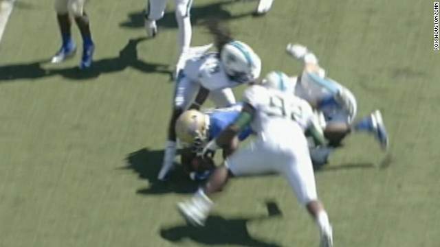 Devon Walker of Tulane (facing the camera) is shown in the instant before he collided with a teammate.