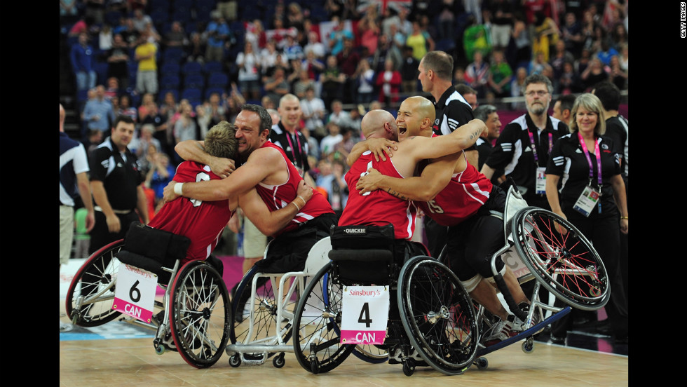 Canadian teammates celebrate after defeating Australia to win the gold medal wheelchair basketball competition Sunday.