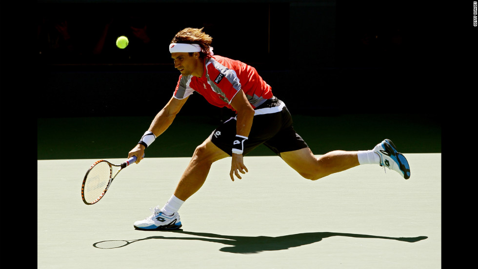 Ferrer returns a shot to Djokovic on Sunday.