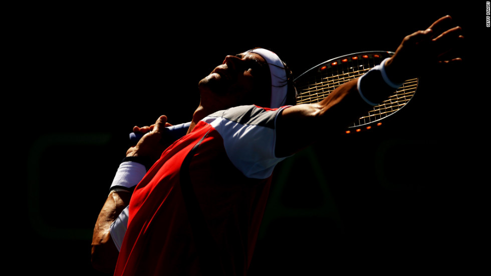 Ferrer, the No. 4 seed, serves to Djokovic, the No. 2 seed, Sunday.