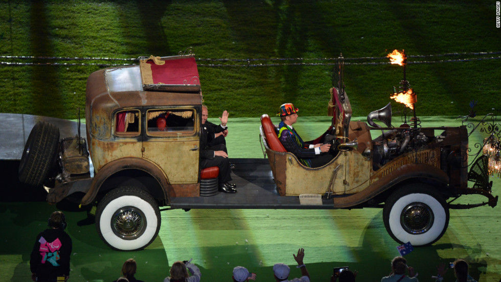 Britain's Prince Edward, Earl of Wessex, waves as he is driven into the arena.