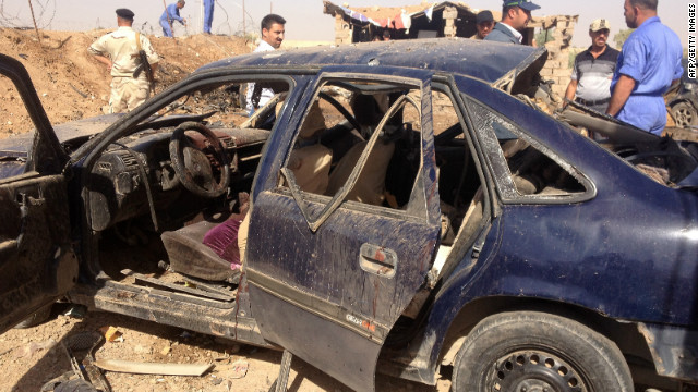 Iraqis on Sunday inspect the site of a blast about 15 kilometers (nine miles) from the northern city of Kirkuk.