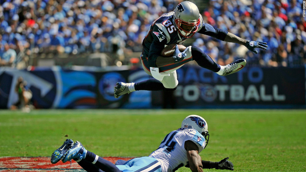 No. 85 Brandon Lloyd of the New England Patriots jumps over No. 24 Coty Sensabaugh of the Tennessee Titans on Sunday.