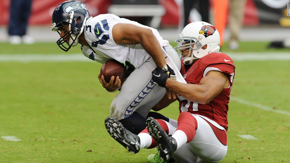 No. 3 Russell Wilson of the Seahawks is sacked by No. 51 Paris Lenon of the Cardinals on Sunday.