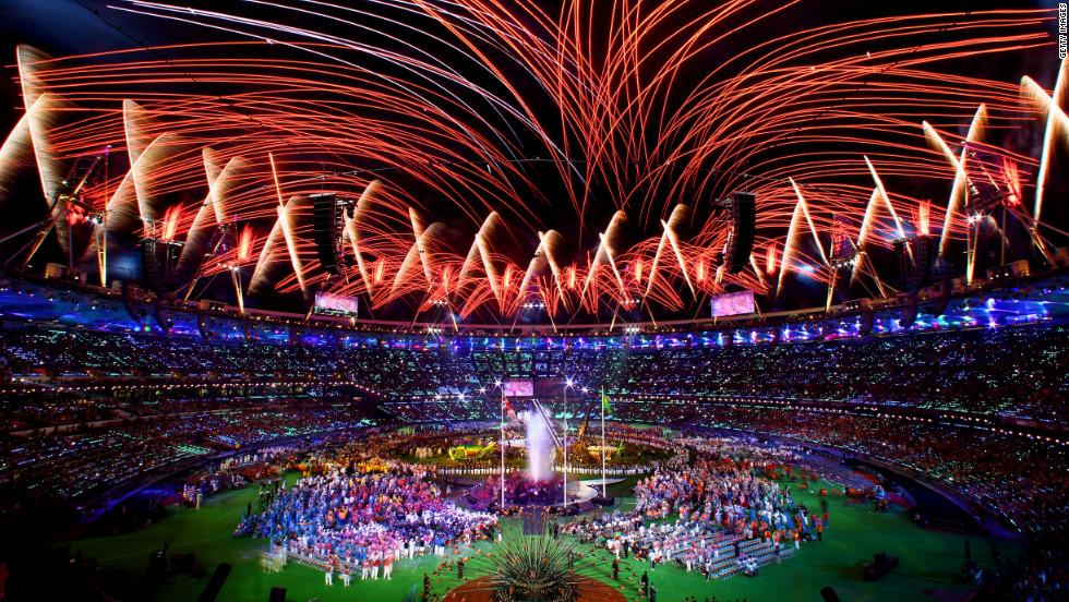 Fireworks crisscross over the arena.