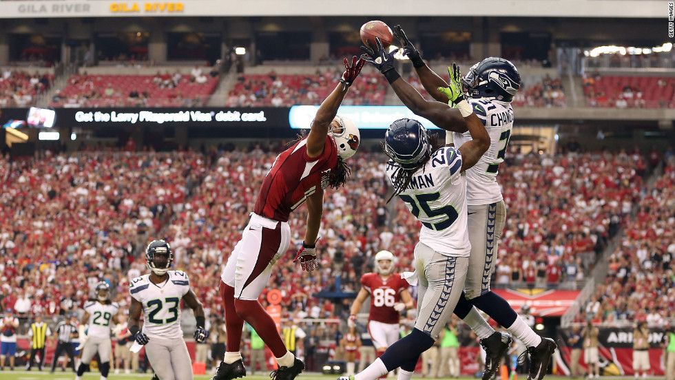 No. 31 strong safety Kam Chancellor of the Seattle Seahawks breaks up a pass intended for No.11 wide receiver Larry Fitzgerald of the Arizona Cardinals during the third quarter on Sunday.