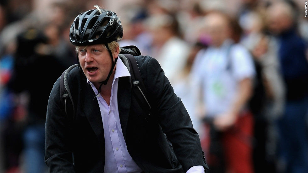 Mayor of London Boris Johnson cycles along the parade route ahead of the arrival of the Team GB and Paralympic GB athletes.