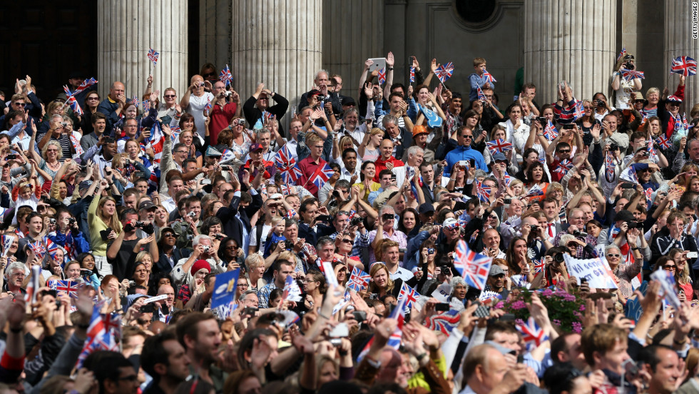 The crowd cheers during the London 2012 Victory Parade for Team GB and Paralympic GB athletes on September 10, 2012 in London, England.